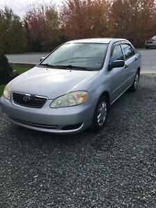 2006 Toyota Corolla w/ 2 extra sets of tires