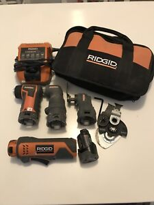 Ridgid multi tool with 3 attachment heads
