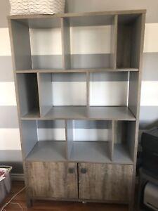 Brand new sturdy bookshelf with cabinets. $130