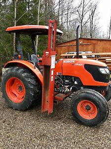 Kubota tractor 2010  with Removable post pounder 600 hours only