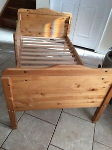 Toddler bed with custom made side railing