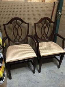 2 solid wood dining chairs for sale.