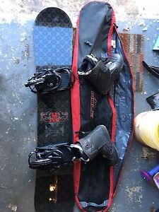 K2 164cm snowboard with K2 bindings, Solomon boots and bag