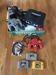 Nintendo 64 with box and instructions, extra controller, 3 games