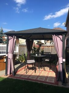 Gazebo with screens and canvas walls