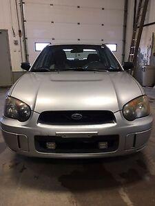 2005 AWD Subaru. Great little run around or winter car.