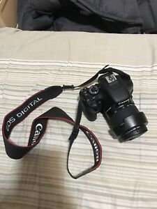 Black canon eos dslr camera