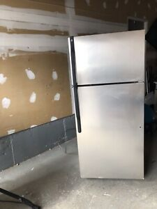 "28""w 65 h Stainless steel GE FRIDGE can DELIVER"
