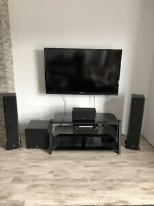 BOSTON ACOUSTIC—Home theatre system with DENON amplifier.