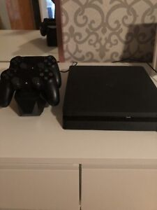 PlayStation 4 with 2 controllers with charging station.