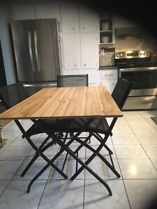 Black foldable table base and 4 chairs