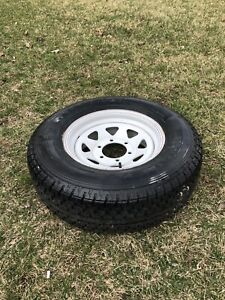 Brand new Trailer tire and rim St225 75 r15 load range D
