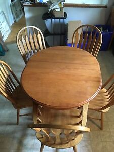 Solid oak table and 5 chairs