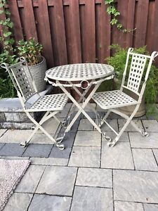 Wrought iron table and 2 chairs ( bistro set ) foldable