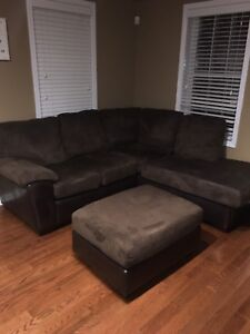 Dark brown 2-piece sectional couch + large ottoman