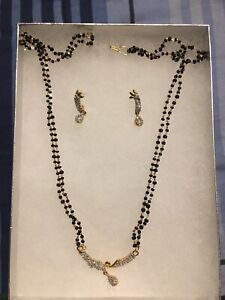 Artificial gold necklace/earrings