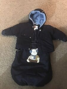 An infant jacket and carrier