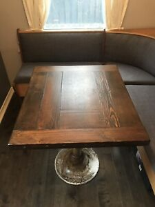 Reclaimed wood table with metal pedestal base