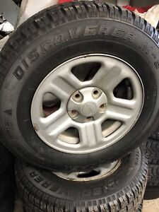 Jeep Wrangler steel rims and snow tires