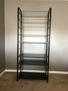 Shelving unit with glass and wood shelves IKEA