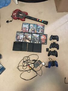 2 play station 2's for sale