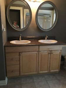Double sink vanity with sinks and faucets.