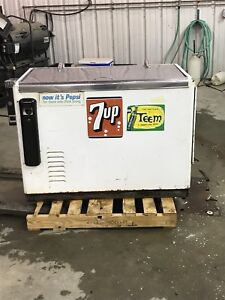 Old 7up cooler and antique TV