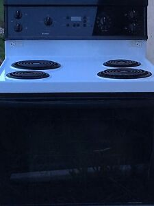Black and white Kenmore Stove