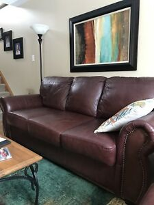 Burgundy leather sofa and love seat