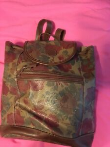 Backpacks and leather wallet purses