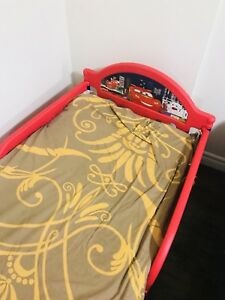 Toddler boys lighting McQueen bed