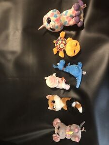 Stuffies in a pet carrier