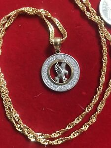 Chain and pendant. 10k yellow gold