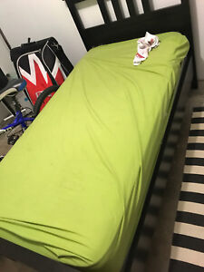 Twin bed with mattress  in excellent condition