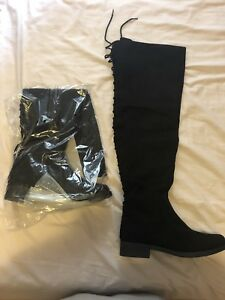 Brand new women's thigh high black boots