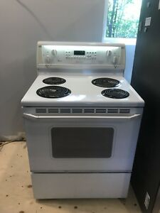 Self cleaning white oven range with convection