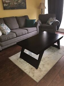 Dark solid wood coffee table  in good condition