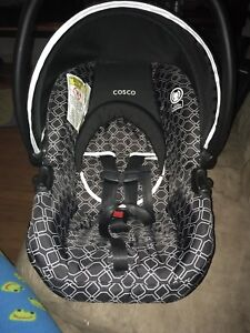 Cosco Light 'N Comfy infant car seat with cover