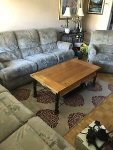 Two reclining sofas and a side recliner chair