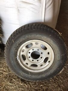 (1) GM Truck 16 Inch Rim with Brand New Tire.