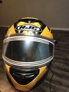 Snowmobile helmet with heated shield