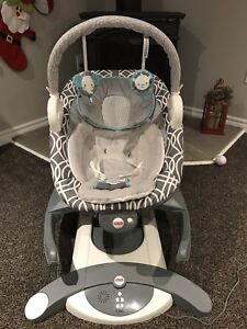 Fisher Price 4 in 1 glider, rocker, soother $100