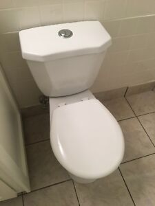 dual flush white toilet like new