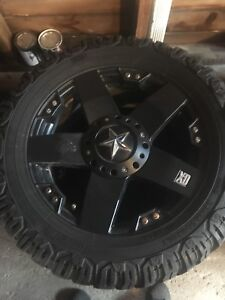 Xd rockstar rims with 33x12.15 mud tires