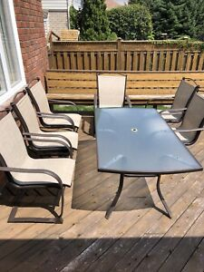 Patio set with 6 sling back chairs