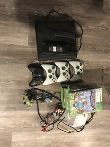 Xbox 360 w/ 4 controllers, Kinect, and lots of games!