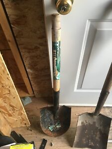 Assorted shovels rakes other hand tools