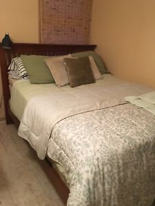Wood bed frame with mattress and box spring