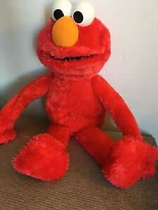 Talking playing ELmo. AVAILABLE