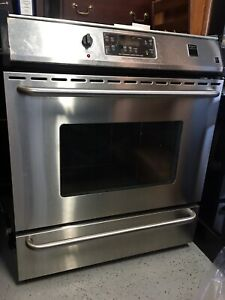 Frigidairs stove for parts,garage heater,tv stand (base)